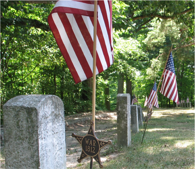 Fort Amanda — gravestones and flags