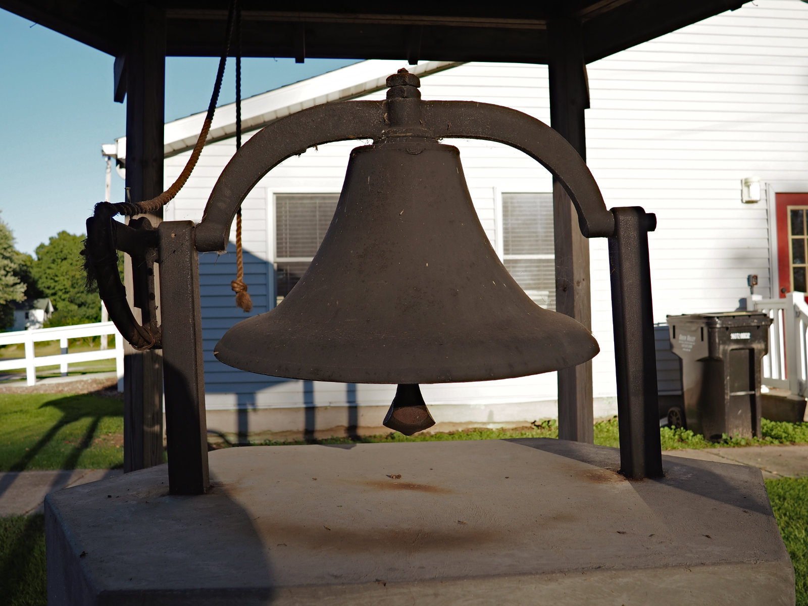 Old schoolbell on the west side of Otisco Township Hall (12 Sep 2016)